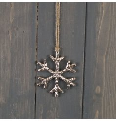 A chic and simple metal hanging snowflake with a rough touch finish and sleek look