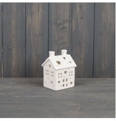 A small ceramic house with an LED glow from its centre