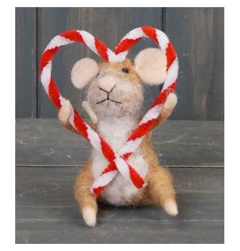 A simple little woollen mouse with a candy cane heart made from pipe cleaners