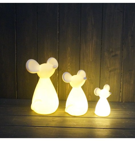 A simple ceramic mouse figure with a warm glowing LED centre