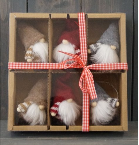 An assorted sized set of hanging gonks within a brown box packaging