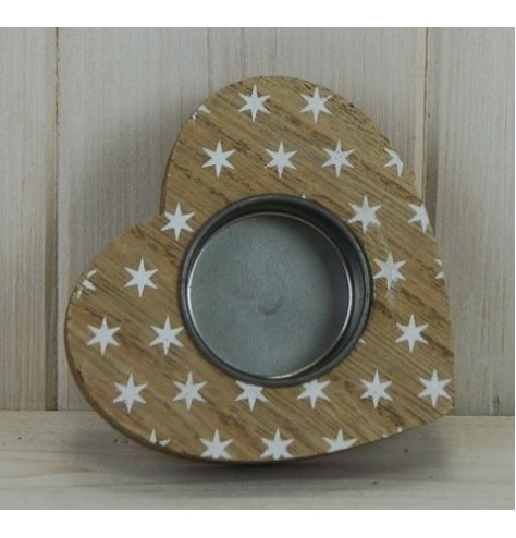 A small wooden tlight holder set with a heart shape and covered with an added white star decal