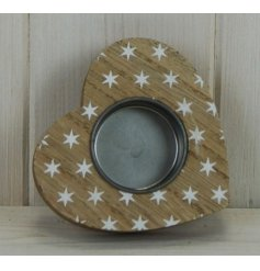 A small heart shaped tlight holder featuring a white star printed decal and rustic finish