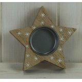 A small star shaped tlight holder featuring a white star printed decal and rustic finish