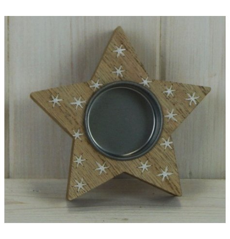 A small wooden tlight holder set with a star shape and covered with an added white star decal
