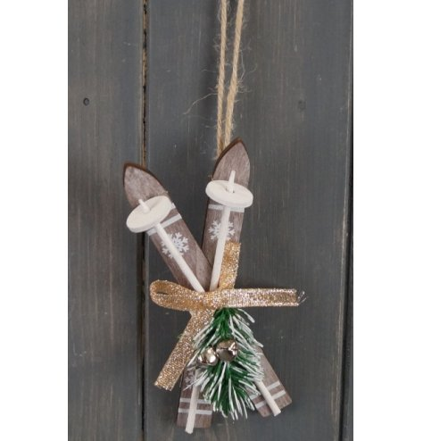 A natural wooden pair of hanging skis, set with a glitter bow and jingle bell finish