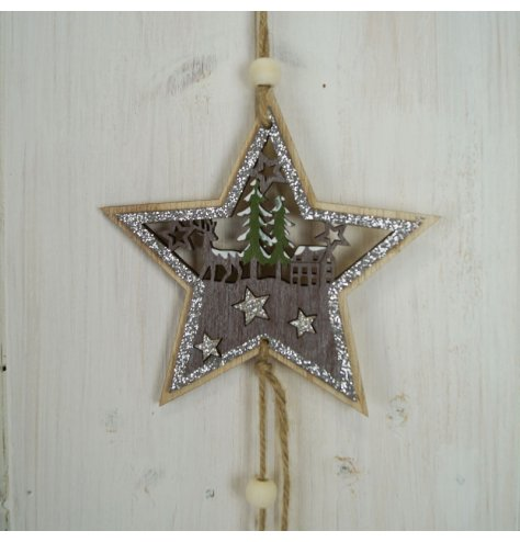 A natural wooden hanging star with a rustic woodland scene inside and a glittery touch to finish