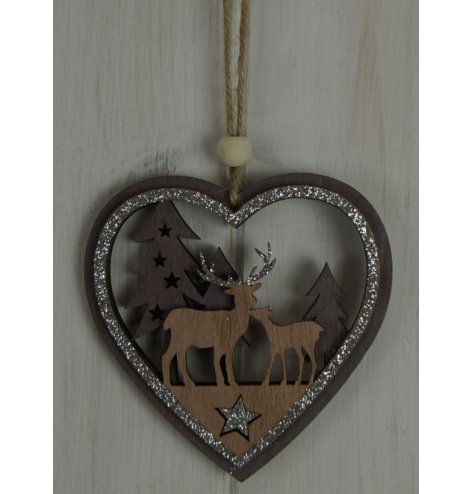 A natural wooden hanging heart with a rustic woodland scene inside and a glittery touch to finish