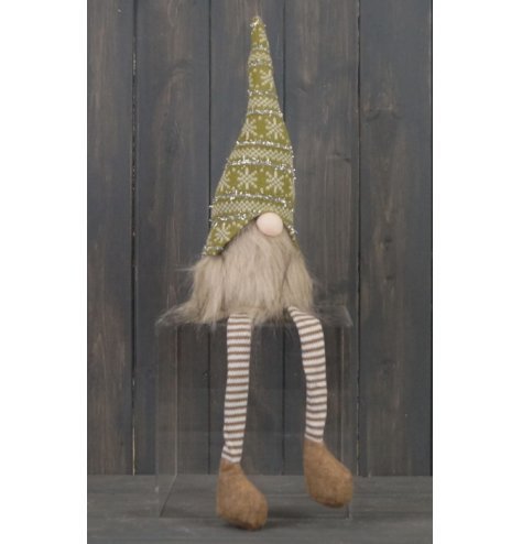 A brown and green toned fabric gonk figure with long dangly legs and faux fur trims