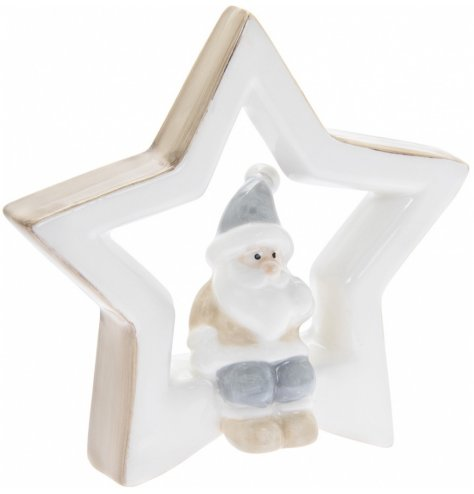 A simple ceramic star complete with neutral colour tones and a perched santa in its centre