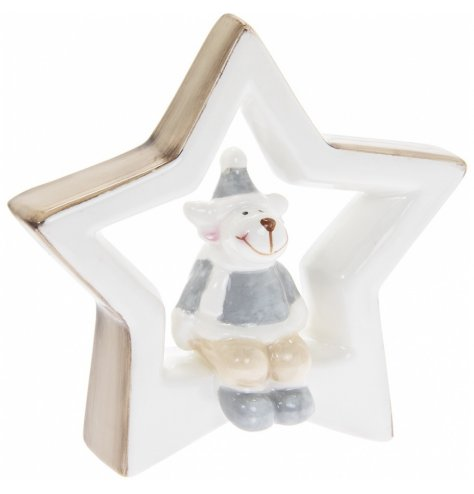 A simple ceramic star complete with neutral colour tones and a perched reindeer in its centre