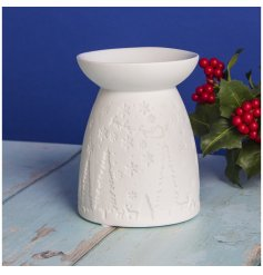 A sleek and simple white toned ceramic tlight holder featuring a large dipped dish and festive surrounding decal