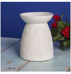 a ceramic tlight holder with a snowflake embossed decal