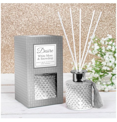A festive scented Reed diffuser presented in a Gatsby inspired gift box, detailed with silvery white tones and a tassel