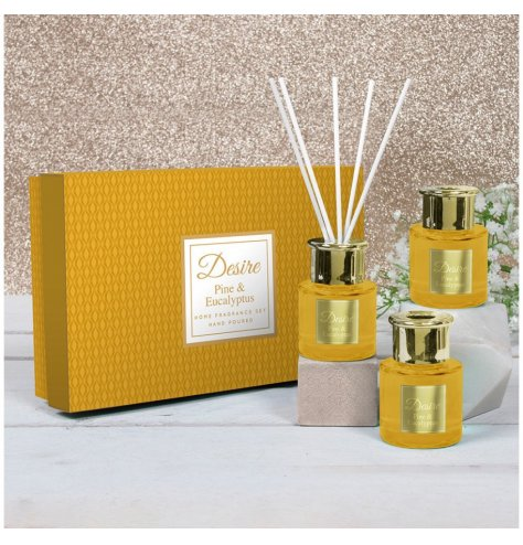 A festive scented set of mini reed diffusers with stunning gold tones and a matching gift box for presentation