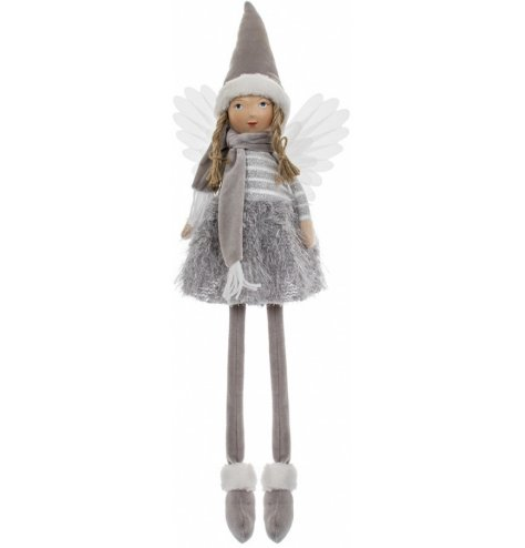 A traditional inspired shelf sitting angel figure, complete with a friendly face, fluffy textures and grey hues