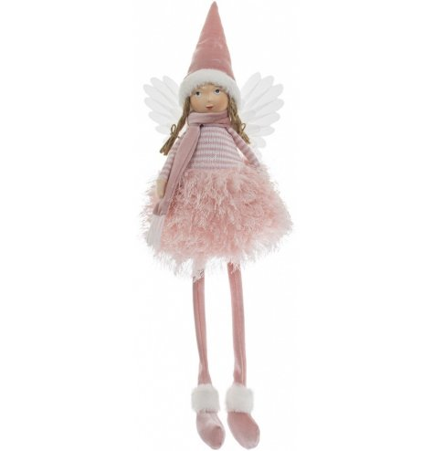 A traditional inspired shelf sitting angel figure, complete with a friendly face, fluffy textures and pink hues