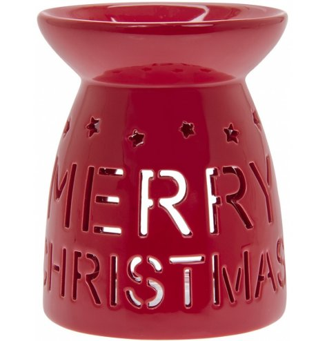A simple red toned ceramic oil burner, decorated with a cut out Merry Christmas text and star decal