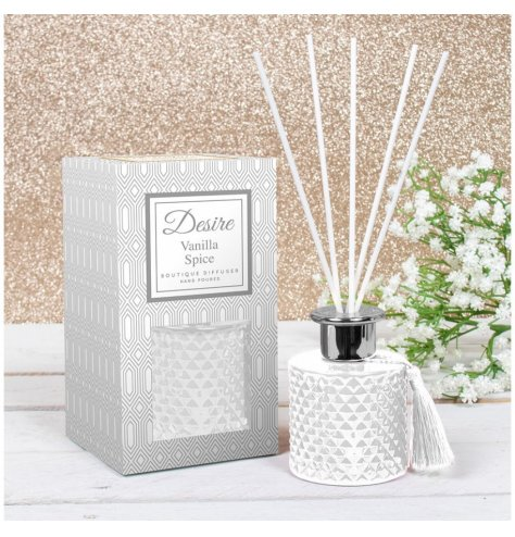 A festive scented Reed diffuser presented in a Gatsby inspired gift box, detailed with white tones and a tassel to finis