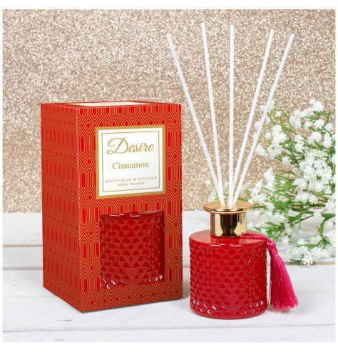 A festive scented Reed diffuser presented in a Gatsby inspired gift box, detailed with Red tones and a tassel to finish