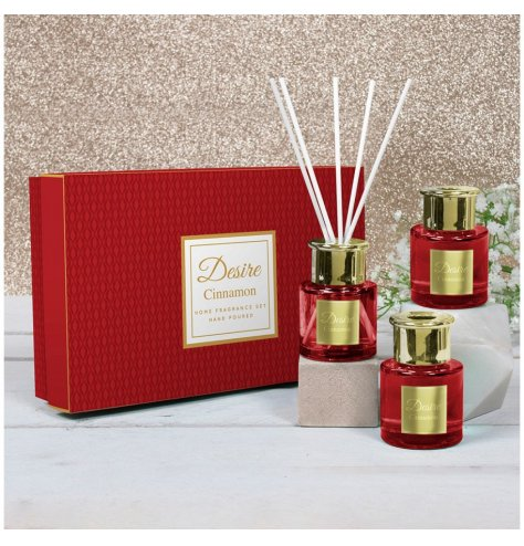 A festive scented set of mini reed diffusers with stunning red tones and a matching gift box for presentation