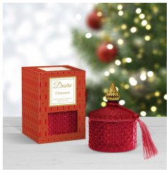 A beautifully detailed glass candle pot set with a stunning red hue, diamond ridge surround and matching tassel finish