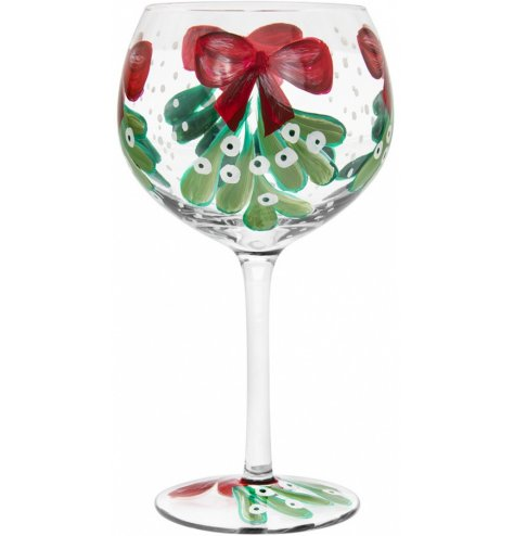 A hand painted stemless glass featuring all the Traditional Colours and themes of Christmas Time