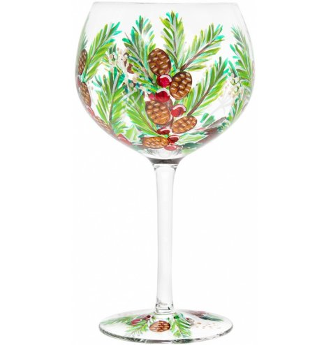 A hand painted balloon gin glass featuring all the Traditional Colours and themes of Christmas Time