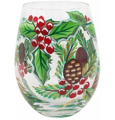 a stemless glass with a beautiful hand painted finish and festive touch
