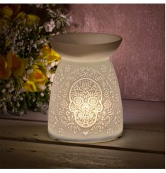 Covered with a stylish Sugar Skull embossment, this gorgeously simple ceramic tlight holder provides a bright and warmin