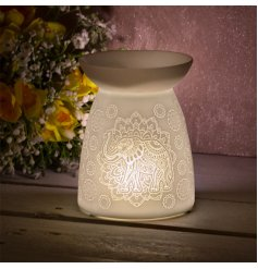 gorgeously simple ceramic tlight holder provides a bright and warming glow to any home space