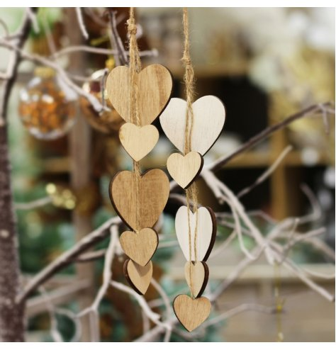 A mix of string hanging heart clusters in an assortment of natural and white wood tones
