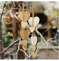 An assortment of hanging cluster heart hangers with neutral tones and added rustic charm