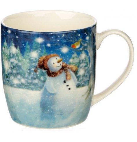 A cute themed ceramic mug featuring a snowman and penguin winter scene