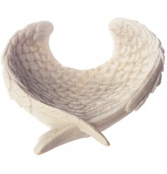 A sleek angel wing shaped bowl with added detail and a simplistic charm