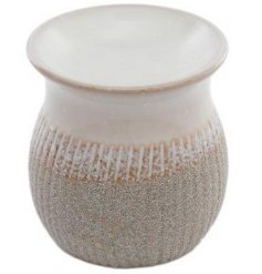 A two toned ceramic oil burner with a neutral colour pallet and rough look finish