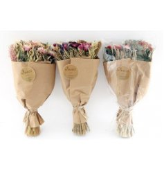 an assortment of bouquets made from real dried out flowers