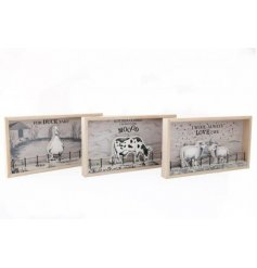 An assortment of Country Charm inspired wooden plaques with a mix of printed decals and motifs