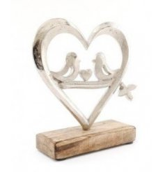 a wooden block based ornament with a heart decal