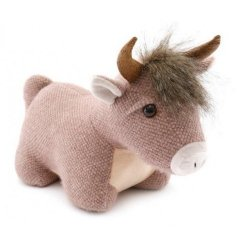 A cute and friendly themed doorstop that looks like a highland cow!