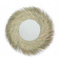 A gorgeous and on trend accessory to bring to any home space, a natural seagrass surrounded mirror with a simple finish