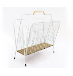 a white wire magazine rack with an added rattan decal