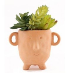 An artificial plant and pot that is sure to bring a Characteristic charm to any windowsill or shelf in the home