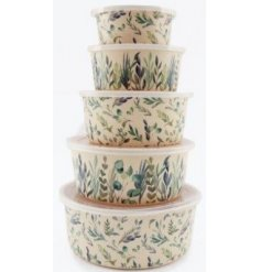 A set of 5 assorted sized bamboo containers that can be stored within each other