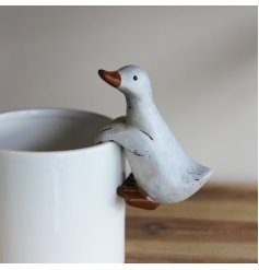 An adorable pot hanging duck figure with a rustic feature and cute charm