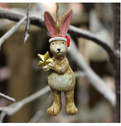 Perfect for the festive season, a hanging bunny with a santa hat and star to complete his look