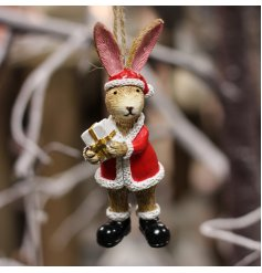A charming little hanging bunny dressed as Santa