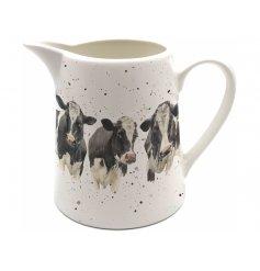 Part of the quirky Bree Merryn Range, a splash art cow printed ceramic jug