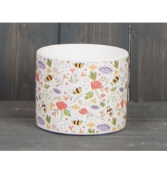 A ceramic based decorative pot covered with a colourful bee inspired decal around it