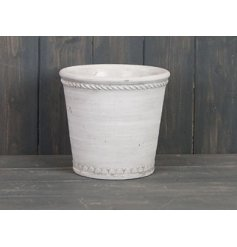 Sure to add a rustic edge to any garden space, a cement based pot with a white colouring and distressed touch